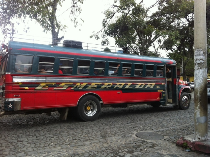 "Local bus aka blinged out American school buses, called ""chicken bus"" or camionetas"